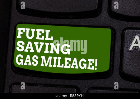 Writing note showing Fuel Saving Gas Mileage. Business photo showcasing Expending less money in vehicle expenses gas savings Keyboard key Intention to - Stock Photo