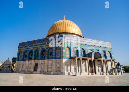 The Dom of Rock on the Temple Mount in the Old City. Dome was constructed by the order of Umayyad Caliph Abd al-Malik 689 and 691 and tiled by sultan  - Stock Photo