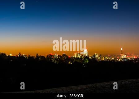 Dawn over the London skyline from Hampstead Heath, London, UK - Stock Photo