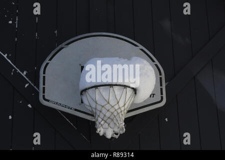 snow covered basketball hoop - Stock Photo