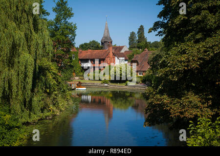 St. Mary's Church at Whitchurch-on-Thames viewed from Pangbourne Toll Bridge - Stock Photo