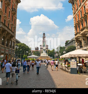 Square streetview of Castello Sforzesco and Torre del Filarete in Milan, Italy. - Stock Photo