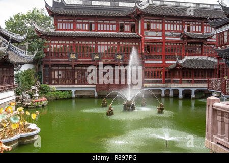 Multiple stream fountain in pond in foreground of Yu Yuan (Yuyuan) bazaar, Shanghai, China. - Stock Photo