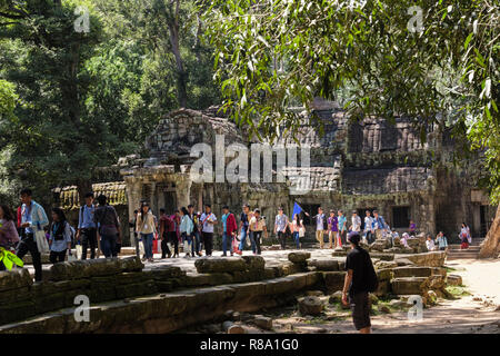 Large numbers of tourists at Ta Prohm Temple ruins in a jungle location. Siem Reap, Cambodia, southeast Asia - Stock Photo