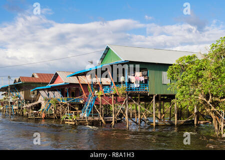 Houses on stilts in floating fishing village in Tonle Sap. Kampong Phluk, Siem Reap province, Cambodia, southeast Asia - Stock Photo