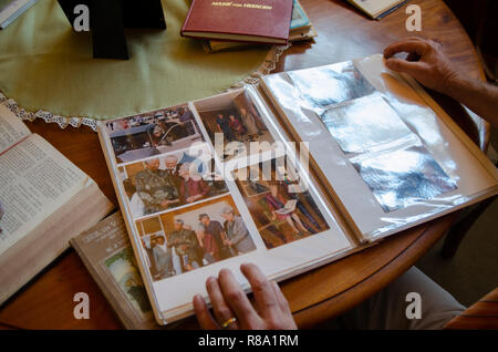 Carel Boshoff (junior) the grandson of H.F. Verwoerd, the mastermind of Apartheid, is looking at a photo album of a 1995 visit from South African President Nelson Mandela, in Orania, the Northern Cape, Friday, December 12, 2013. Photo: Eva-Lotta Jansson - Stock Photo