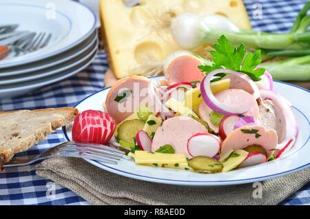 Bavarian sausage salad with cheese - Stock Photo