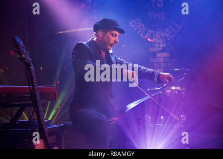 Leeds, UK. 13th Dec 2018. American rock band Mercury Rev in concert at Brudenell Social Club, Leeds, UK, 13 December 2018. Jonathan Donahue plays the musical saw during the gig. Credit: John Bentley/Alamy Live News - Stock Photo