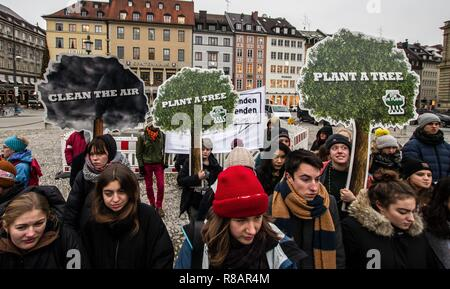 Munich, Bavaria, Germany. 14th Dec, 2018. As part of a worldwide action, 100 students and concerned citizens participated in a climate strike at Munich's Max Joseph Platz. The protestors are calling on world governments to take decisive action against climate change.The Friday strikes were started by 15 year old Swedish student Greta Thunberg who strikes in front of the Parliament in Stockholm on Fridays instead of attending classes. Thunberg is currently in Katowice, Poland, where she's attending the COP24 climate talks. Credit: Sachelle Babbar/ZUMA Wire/Alamy Live News - Stock Photo