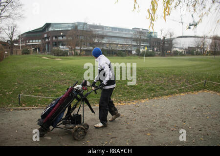 London UK. 15th December 2018. Golfers playing on a cold day  at the Wimbledon Park Golf Club. The All England Lawn Tennis Club (AELTC) has purchased  the neighbouring golf course at the  73-acre site  of the  120 year-old golf club for £65 million ($81.9 million). The new land will be used to allow more practice courts and better facilities for qualifying events Credit: amer ghazzal/Alamy Live News - Stock Photo