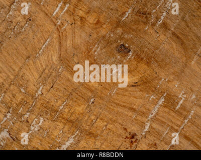 Old wooden brown plank with grooves and a weathered look. - Stock Photo