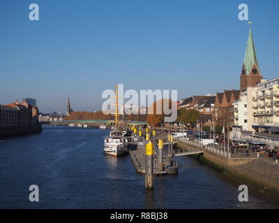 Bremen, Germany - View of the river Weser and the historic Schlachte waterfront with the spire of St. Martini church - Stock Photo