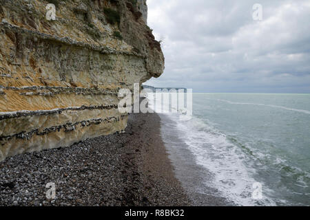 Opale Coast, Picardy, France, layers of flint in chalk cliffs, cretaceous, sedimentary rock, stormy sea. - Stock Photo
