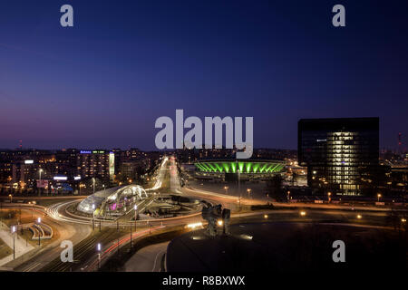 Silesian metropolis Katowice in Poland at night with spodek @ blue hour and clear blue sky; nice view from the rooftop of Hotel Katowice - Stock Photo