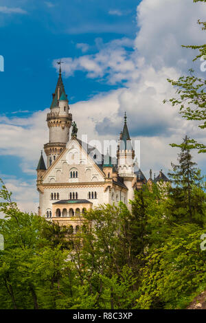 Romantic view of the beautiful west façade of the famous Neuschwanstein Castle, a Romanesque Revival palace at the village of Hohenschwangau near... - Stock Photo