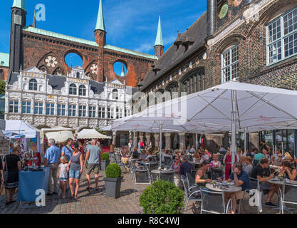 Cafe in front of the historic 13th century Rathaus (Town Hall), Markt, Lubeck, Schleswig-Holstein, Germany - Stock Photo