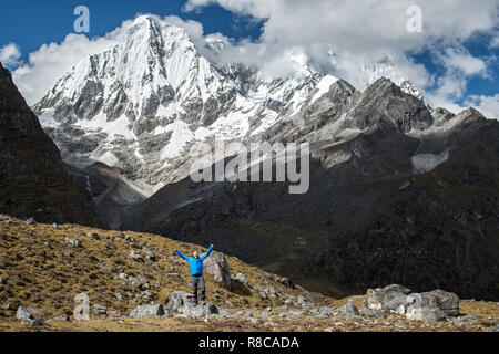 Happy trekker at the foot of Gangchhenta (Great Tiger Mountain), Gasa District, Snowman Trek, Bhutan - Stock Photo