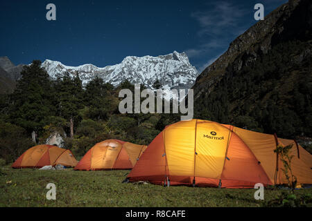 Night photo at Lemithang camp at the foot of Gangchhenta (Great Tiger Mountain), Gasa District, Snowman Trek, Bhutan - Stock Photo