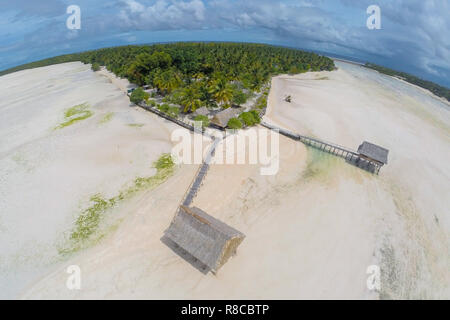 Traditional authentic over water thatched roof wooden bungalow of native local aborigines Micronesian people in lagoon of an atoll, North Tarawa, low  - Stock Photo