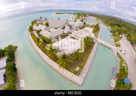Maneaba ni Maungatabu (Parliament of Kiribati) building on motu in an atoll's lagoon, aerial view. House of Assembly, Ambo, South Tarawa, Kiribati, Gi - Stock Photo