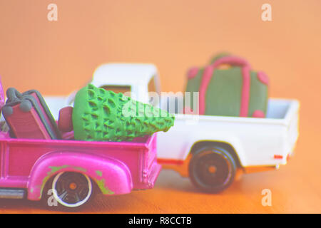 Miniature of a small travel Christmas car. - Stock Photo