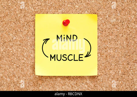 Mind-Muscle connection arrows concept written on yellow sticky note pinned on bulletin cork board. - Stock Photo