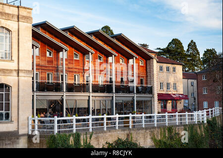 Mix of old and new, residential and commercial property overlooking the River Avon in Bradford on Avon, Wiltshire, UK. - Stock Photo