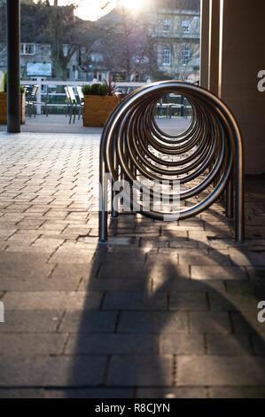 Unusual bike rack in pedestrian precinct in Bradford on Avon, Wiltshire, UK. - Stock Photo