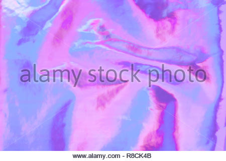 Holographic bright rainbow multicolor real crumpled texture background. - Stock Photo