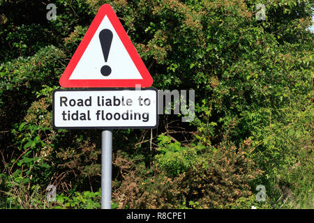 Road liable to tidal flooding sign - Stock Photo