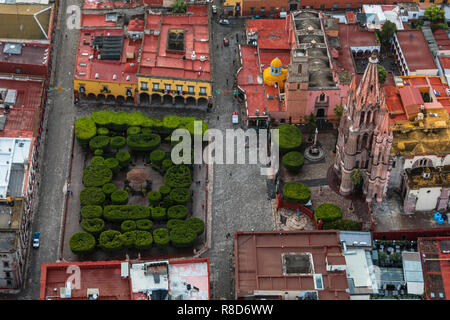 The PARROQUIA DE SAN MGIUEL ARCANGEL and the JARDIN as seen from an early morning HOT AIR BALLOON ride - SAN MIGUEL DE ALLENDE, MEXICO - Stock Photo