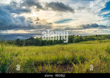 Dramatic clouds over the ocean, looking west from the first pull out on highway 550, Waimea, Kauai, Hawaii - Stock Photo