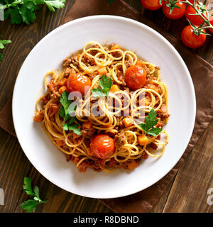 Pasta, spaghetti with minced meat and vegetables on wooden table. Top view, flat lay - Stock Photo
