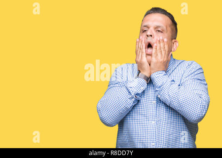 Middle age arab business man over isolated background Tired hands covering face, depression and sadness, upset and irritated for problem - Stock Photo