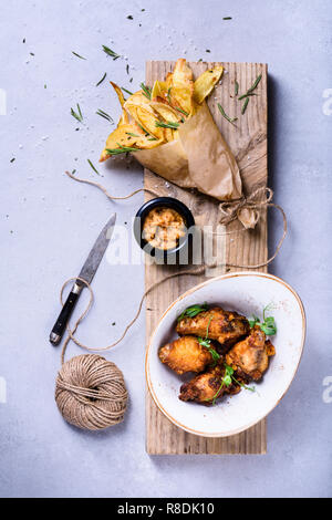 Fried chicken wings bbq with potato chips, top view, copy space. - Stock Photo