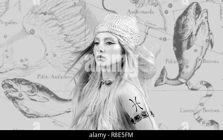 Pisces Zodiac Sign. Astrology and horoscope concept, Beautiful woman Pisces on zodiac map - Stock Photo