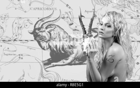 Capricorn Zodiac Sign. Astrology and horoscope concept, Beautiful woman Capricorn on zodiac map - Stock Photo