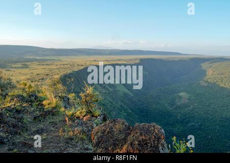 Hiking along the volcanic crater on Mount Suswa, Kenya - Stock Photo
