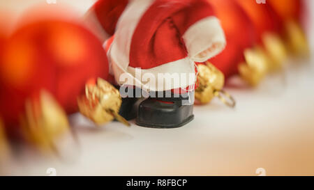 Santa Claus and red Christmas balls on a light background. MERRY CHRISTMAS.WEB BANNER. - Stock Photo