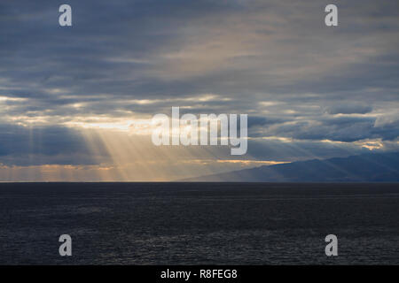Sun rays are shining through the clouds - Stock Photo