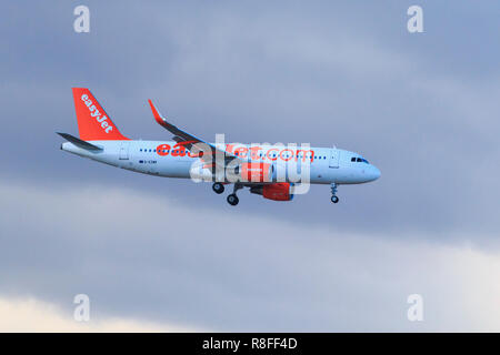 Airplane Airbus A320-214 easyJet landing in Tenerife aiport - Stock Photo