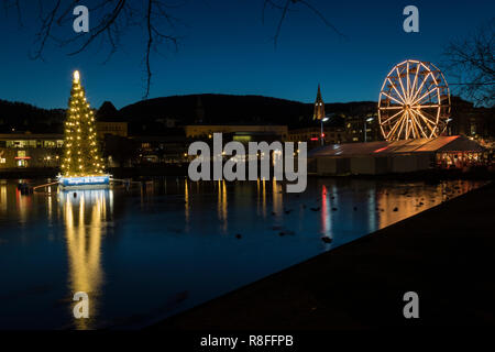 Christmas Market by Lille Lungegaardsvannet Lake in downtown Bergen, Norway - Stock Photo