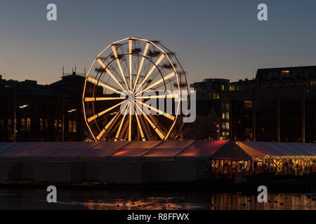Christmas Market by Lille Lungegaardsvannet Lake in downtown Bergen, Norway. Ferris wheel rotating. - Stock Photo
