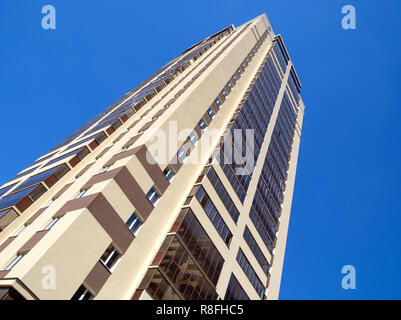 New high-rise building on the background of clear sky - Stock Photo