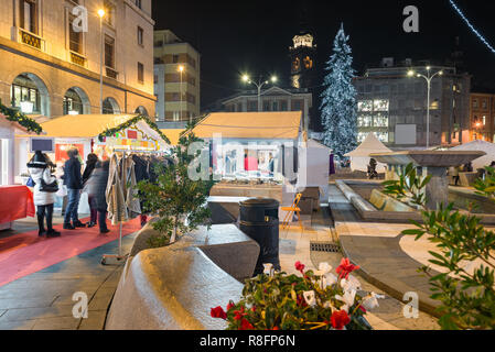 Christmas market in the evening. Stalls in a city of northern Italy - Stock Photo