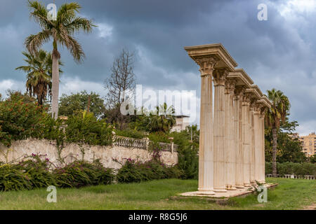 Roman Columns and Palm Trees in Garden - Stock Photo