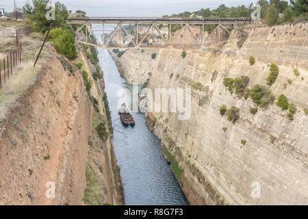 Boat crossing the Corinth channel in Peloponnese Greece - Stock Photo