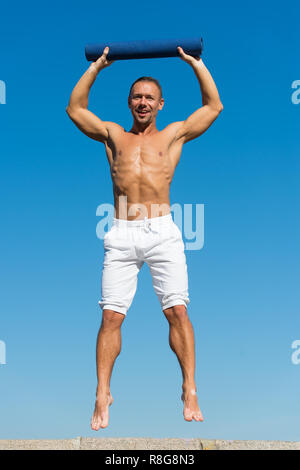 I feel like I need the balance. Man do sport and health activities. Muscular man enjoy good health. Developing muscular strength and power. Success in sport. Success is hard work. - Stock Photo