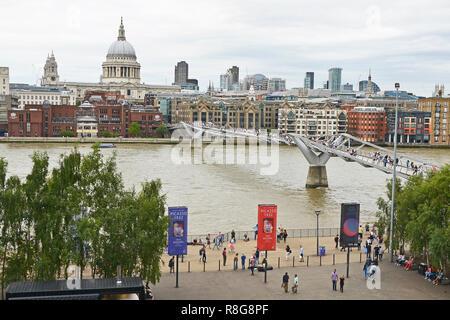 THE MILLENNIUM BRIDGE, THAMES EMBANKMENT, LONDON. AUGUST 2018. The Millennium Footbridge asuspension bridge over the River Thames with St Pauls - Stock Photo