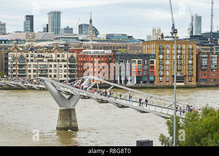THE MILLENNIUM BRIDGE, THAMES EMBANKMENT, LONDON. AUGUST 2018. The Millennium Footbridge a suspension bridge over the River Thames with the skyline of - Stock Photo